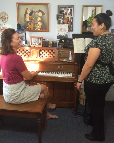 Photo of Gail teaching a student